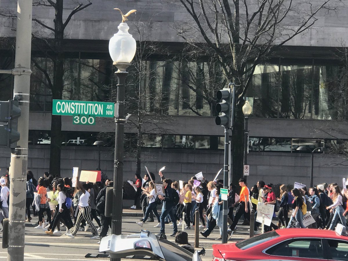 """Students marching for gun control - hundreds on Constitution ave in DC right now yelling """"this is what democracy looks like!"""""""
