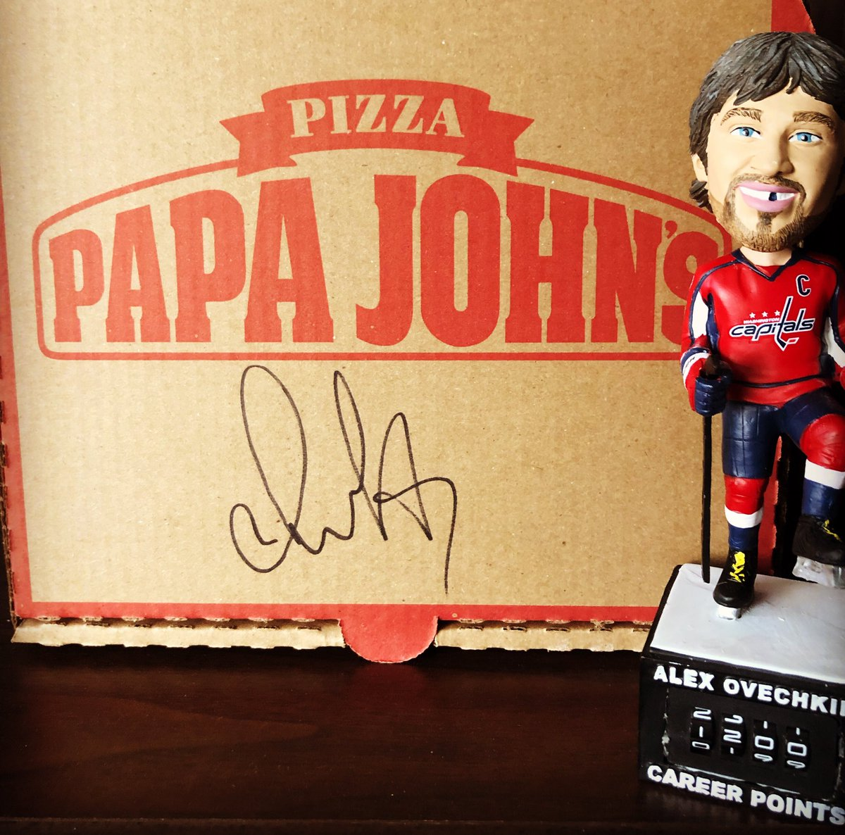 Congratulations to @ovi8 on 1200 career points! We're celebrating with Any Large Specialty Pizza for just $12.00.  RT & Follow for your chance to win this signed Alex Ovechkin pizza box! #PizzasHere🍕 #ALLCAPS  No purch nes, ends 3/18, rules: http://bit.ly/2TObZEK