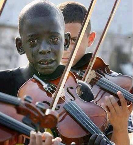 MUSIC POWER!  Child playing the violin @ his teacher&#39;s funeral who helped him escape poverty and violence through music. #FridayFeeling  #FridayMotivation <br>http://pic.twitter.com/o1FCovGas3