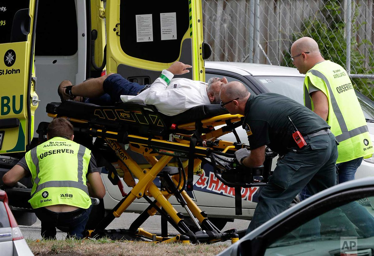 Ambulance staff take a man from outside a mosque, today in central Christchurch, New Zealand. At least 49 people were killed in mass shootings at two mosques full of worshippers attending Friday prayers. http://apne.ws/WhcLA2f | Photo Mark Baker