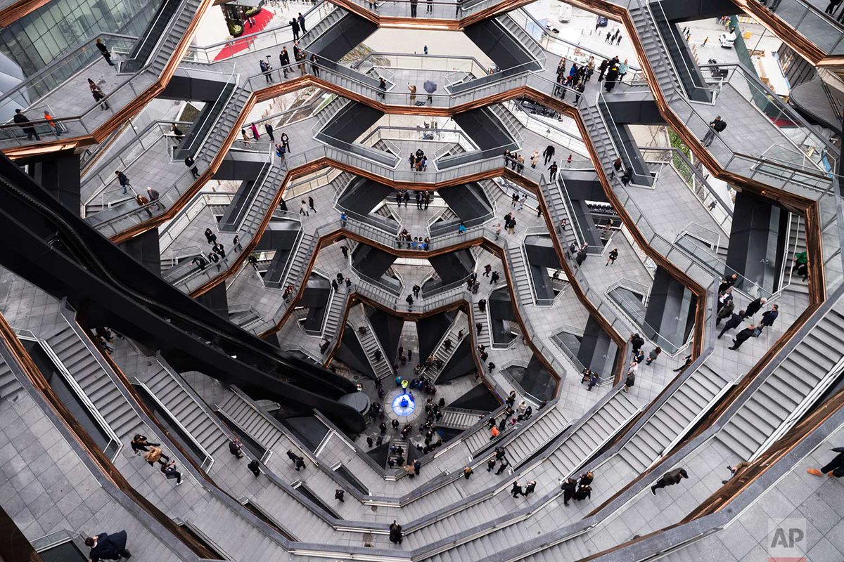 """Visitors to """"Vessel"""" climb its staircases on its opening day at Hudson Yards, today in New York. http://apne.ws/QfNRCBS @marklennihan"""