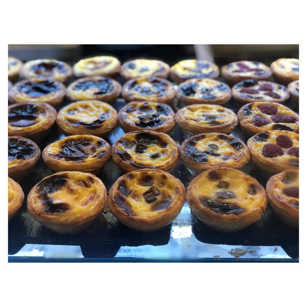 It's Saturday so I'll have one of each 🤤  #cafedenata #pasteisdenata #custardtarts #coffee #cafe #strawberry #chocolate #blueberry #apple #cinnamon #coconut #raspberry #classic #latte #nomnom #yum #weekendvibes #london #soho #hammersmith #southkensington #portugal #pastelaria