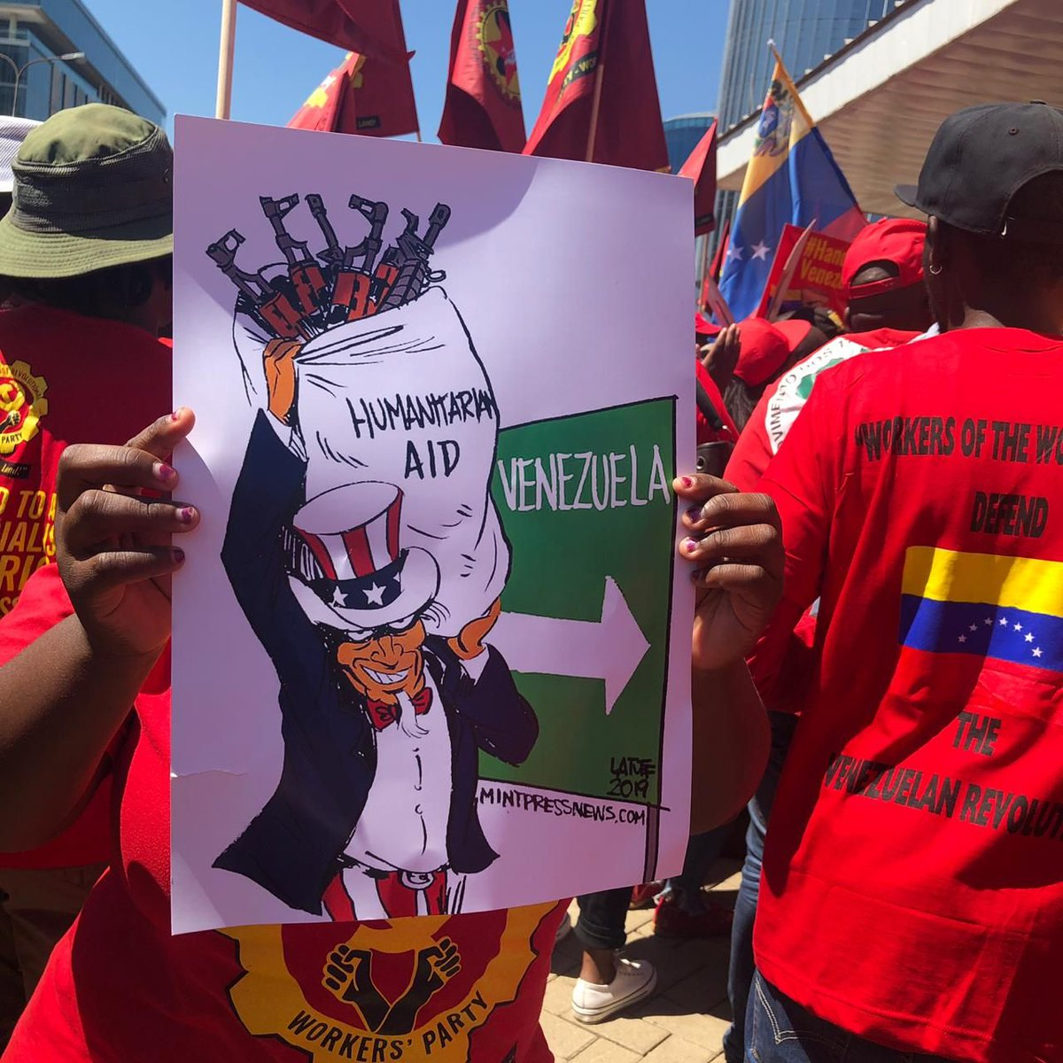 #InPictures | Outside #UnitedStates Embassy in #Johannesburg this morning. Socialist Revolutionary Worker&#39;s Party Numsa, Socialist Party Zambia and other left formations picketing for the past four hours and concluding with handing over a Memorandum. #Venezuela #HandsOffVenezuela <br>http://pic.twitter.com/1rxV3J5M2L