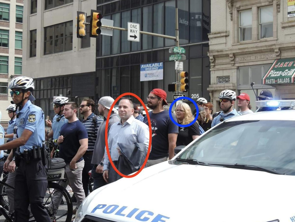 Alright, moving on to the next photo: here&#39;s Billy (in red) and, a couple paces behind him, a woman I&#39;ve been told is Holly Delcampo. Along with Zach Rehl, Holly organized the 11/17 Proud Boys march.   Holly is also known for her charming denial of Heather Heyer&#39;s murder. <br>http://pic.twitter.com/nGSmB89PmH