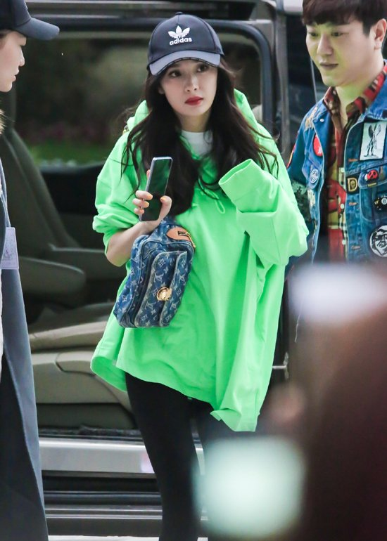 a58e4c5799bdf Chinese actress  YangMi was spotted wearing  WE11DONE s logo oversized  hoodie at Hangzhou airport on