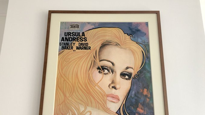 Happy Birthday to Ursula Andress... and here she is looking down at me from above the fireplace as usual