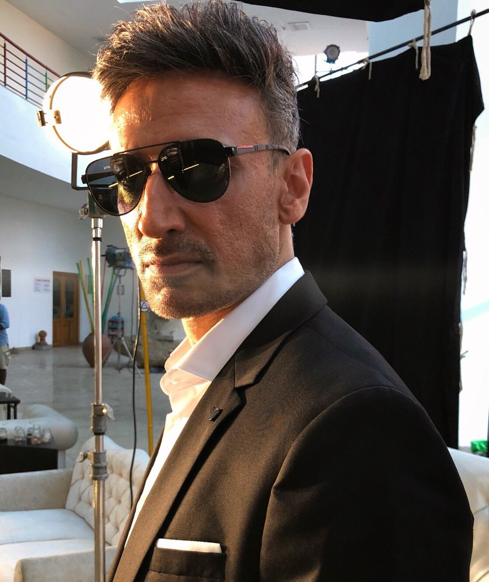 Keeping a straight face amidst the chaos .... at work #actorslife #lovemyjob #photooftheday #shades #prada #suit #boss