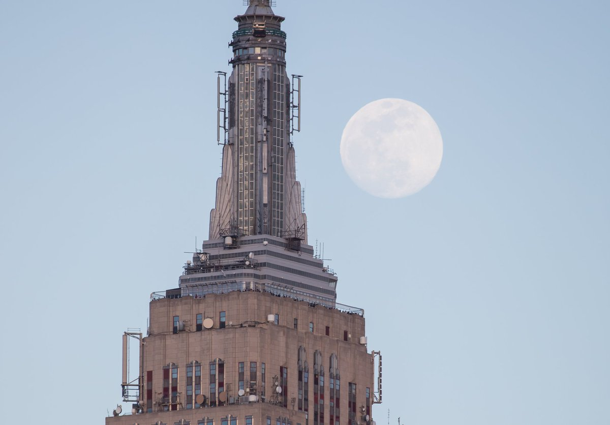Yesterday's near full moon rising above the Empire State Building #NYC