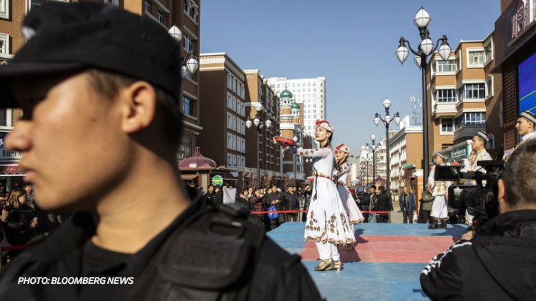 """""""Hello, dear tourists!"""" a recorded voice on a loudspeaker says in a former Uighur commercial center in Urumqi that now resembles a theme park. Pedestrian promenades guarded by large security gates have replaced streets that once hummed with activity and tension."""