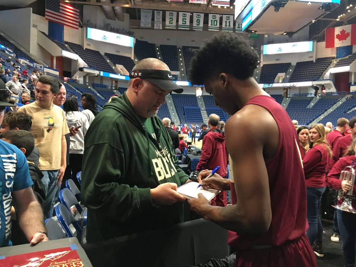 FSU forward Terance Mann signs an autograph for a fan after the Seminoles' shootaround Wednesday in Hartford. #NCAATourney<br>http://pic.twitter.com/jxTRkWVnqG