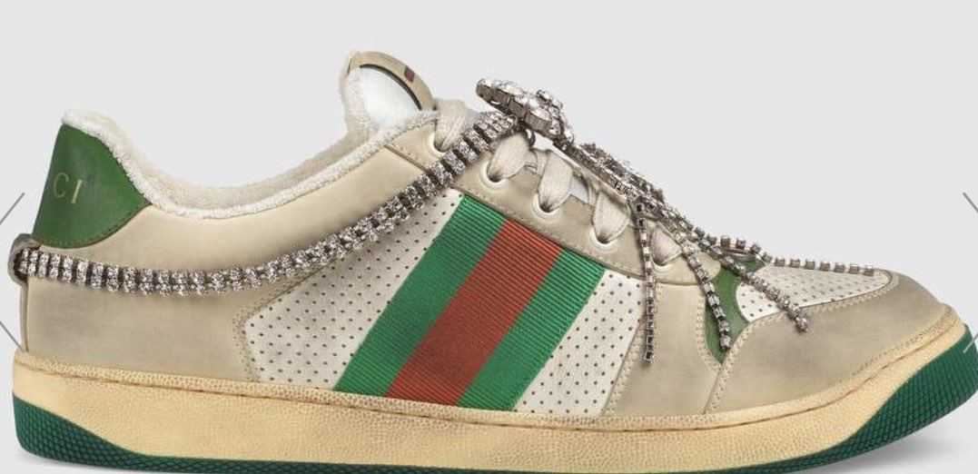 "6067e4711 ""There are actually four versions of the new Gucci dirty sneaker. The first  three are $870 each, the last one comes with crystals and is $1,590 a pair."""