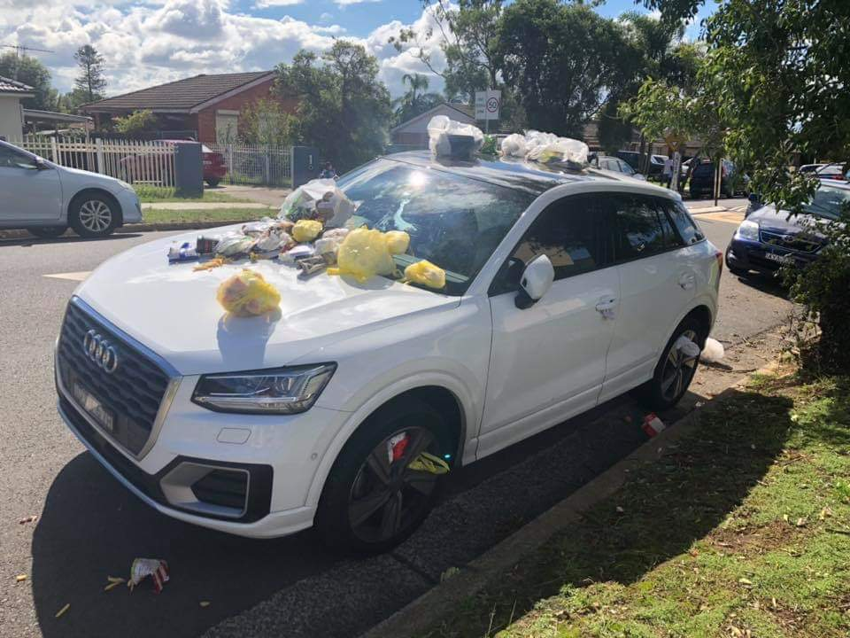 A Muslim teacher's car outside Islamic school in #Australia: It's not flowers, it's an entire wheelie bin full of rubbish! #Islamophobia