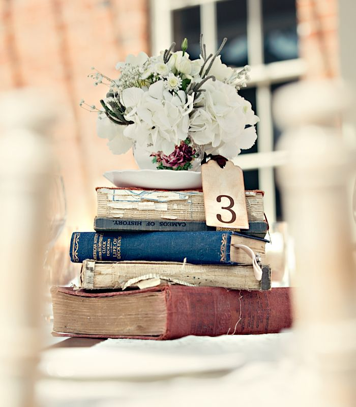 Creative Ways to Use Flowers in Your Wedding: Add a gorgeous chabby chic effect by stacking teacup adorned floral centrepieces on some of your favourite old books! #weddings #weddingideas #weddingflowers #UKHashtags #UKSOPRO #weddingdecor <br>http://pic.twitter.com/ZF6GR53KmV