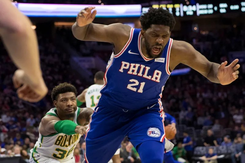 Marcus Smart looks also bored shoving Joel Embiid in the picture.