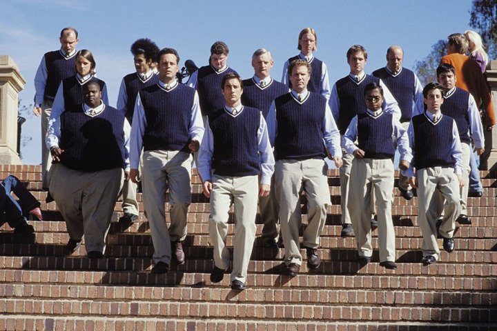 "Frank the Tank, ""Blue,"" and a couple dozen identically preppily dressed guys walking down the steps of their college as the cast of Old School (movie)"
