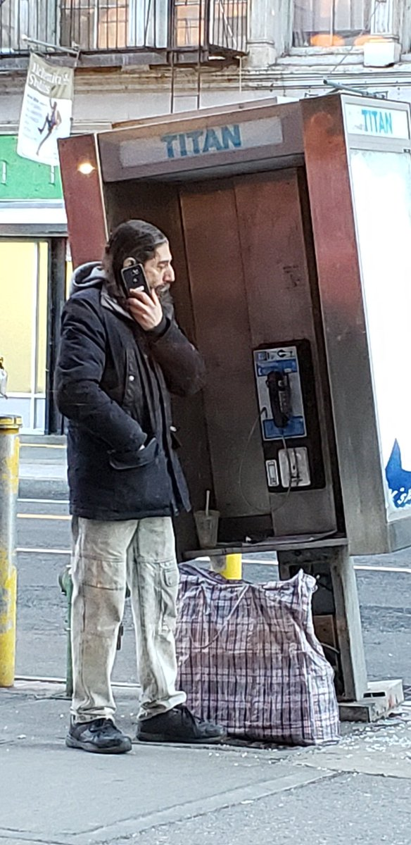 Guy calling from bent phonebooth on #West14thSt #Village #Chelsea #nyc