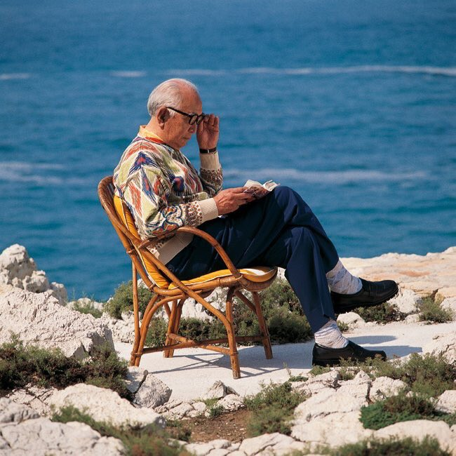 image of Kurosawa reading by the sea please grant me peace of mind to get me through a shitty day
