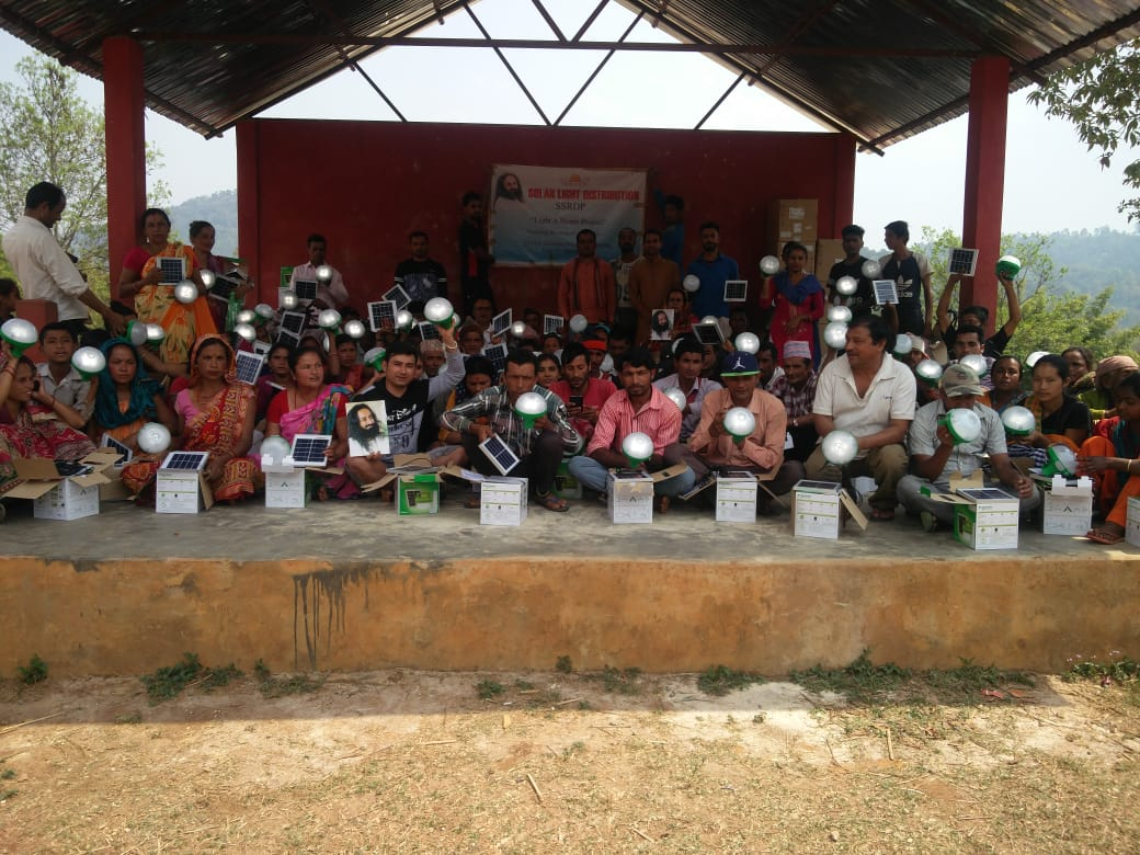 .@ArtofLiving volunteers distributed solar lights to the tribals of Umlapher, West Karbi Anglong, Assam, an extremely remote hilly area with broken roads & no electricity.
