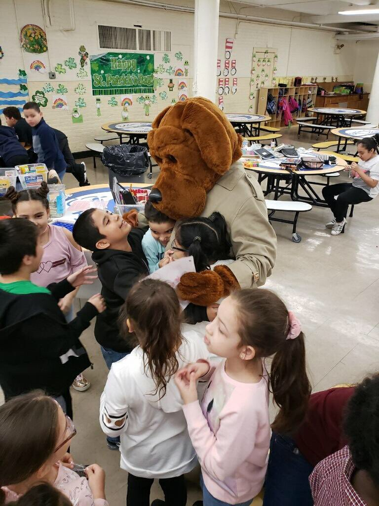 Earlier this week Community Affairs officers from the @NYPD52Pct brought a special guest to St. Brendan's School in the Bronx. McGruff the crime dog spent time playing games with the students and informing them on how they can take a bite out of crime.