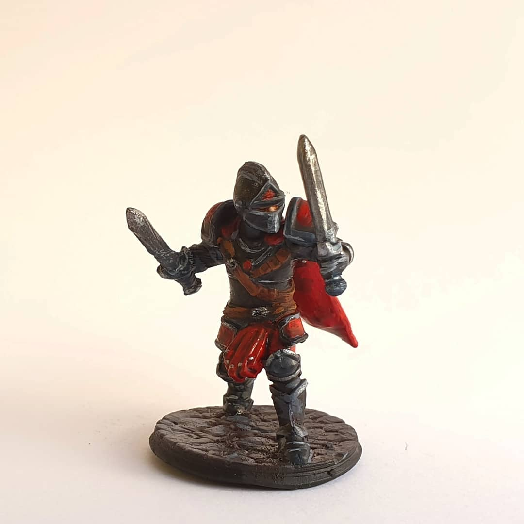 The painted mini for the IG giveaway winner.  #dungeonsanddragons #dandd #dnd #miniatures #miniaturespainting #painting #minifigure #party #penandpaper #d20 #rpg #role #characters #art #handpainted  #armour #armor #swords #black #red #cape #cloak #redcape #cristyillustrations