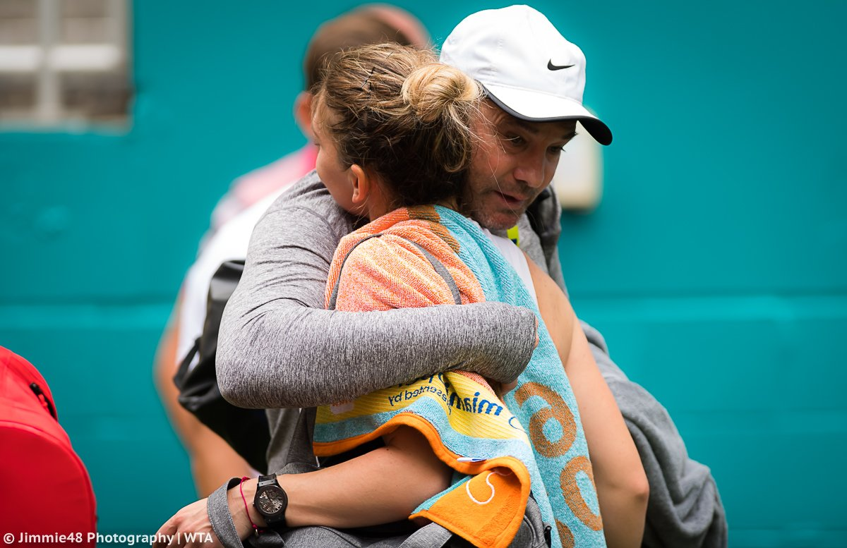 .@Simona_Halep hugs coach Daniel Dobre after making the fourth round at the Miami Open