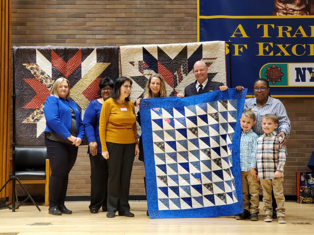 Dozens of quilters came together today at Police Headquarters with @NYPDChiefofDept to give out handmade quilts to the families of officers who passed on 9/11 or from the effects of working at Ground Zero and to honor their memory.