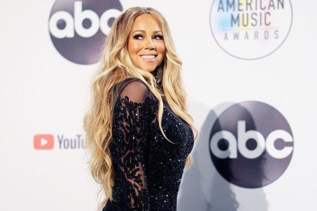 Happy 50th(?) birthday Mariah Carey!