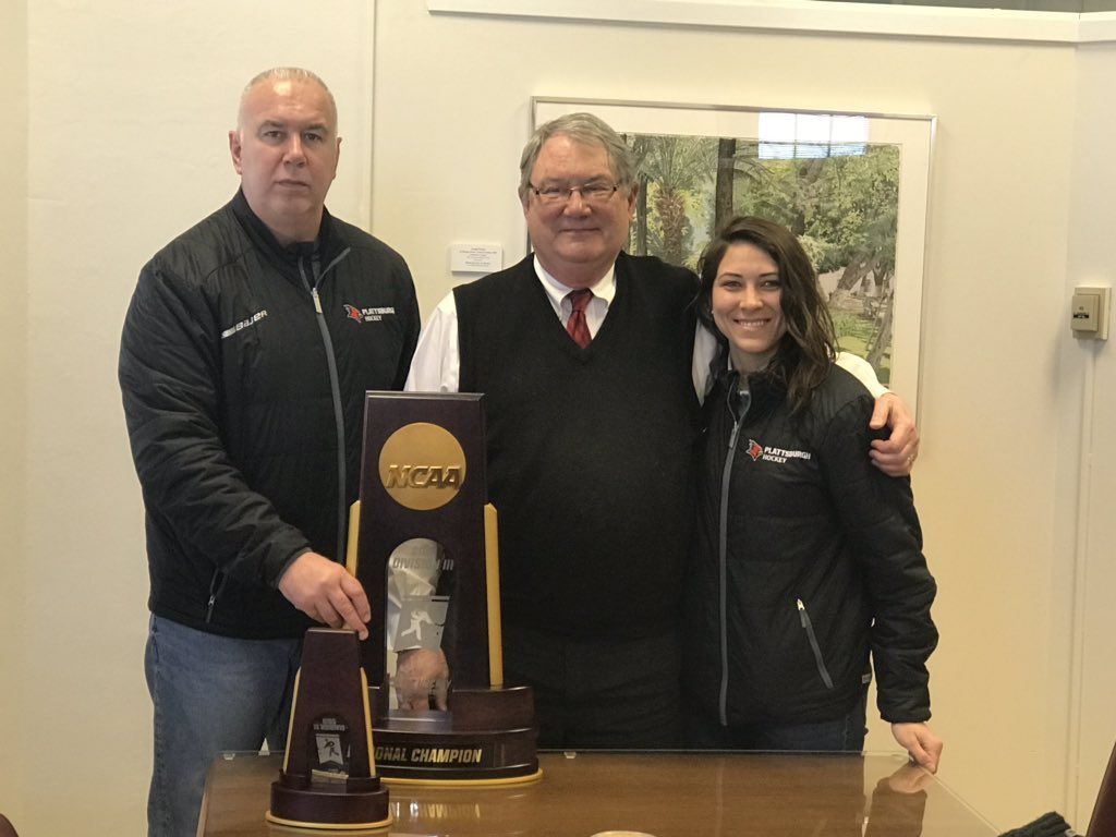 WHKY | @SUNYPlattsburgh President John Ettling, head coach Kevin Houle and assistant coach Danielle Blanchard with the @CardinalsWHKY national championship trophy in Hawkins today! #CardinalCountry