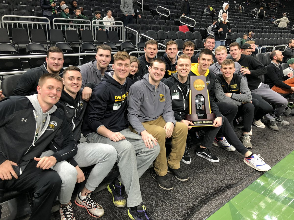 Special guests at the @Bucks game tonight are the D-III National Champions of @UWOMBB. They brought the hardware.