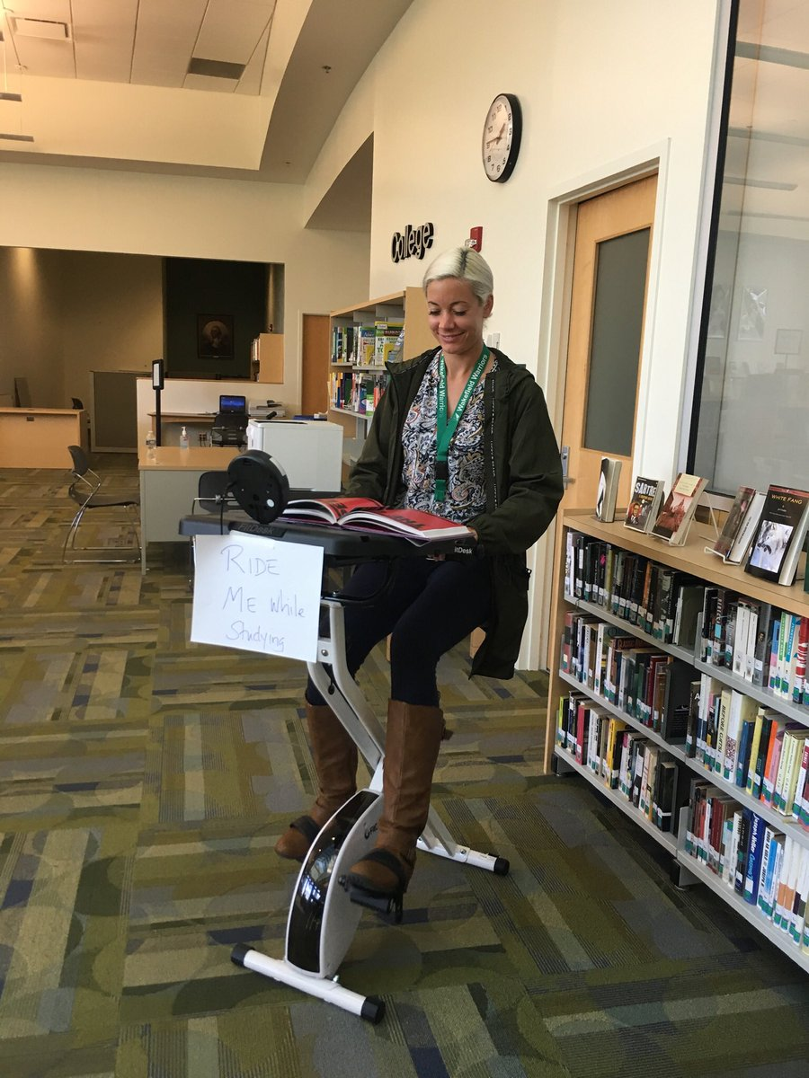 The talented Ms. Peters is reading &amp; exercising. Come try out the new stationary bike in the library. <a target='_blank' href='http://twitter.com/WHSHappenings'>@WHSHappenings</a> <a target='_blank' href='http://twitter.com/APSLibrarians'>@APSLibrarians</a> <a target='_blank' href='http://twitter.com/wakefieldchief'>@wakefieldchief</a> <a target='_blank' href='http://twitter.com/WakeAthletics'>@WakeAthletics</a> <a target='_blank' href='http://twitter.com/principalWHS'>@principalWHS</a> <a target='_blank' href='http://twitter.com/wasamshsu'>@wasamshsu</a> <a target='_blank' href='http://twitter.com/bsanders138'>@bsanders138</a> <a target='_blank' href='http://twitter.com/wakefieldwrites'>@wakefieldwrites</a> <a target='_blank' href='https://t.co/PXgGw6Xurz'>https://t.co/PXgGw6Xurz</a>