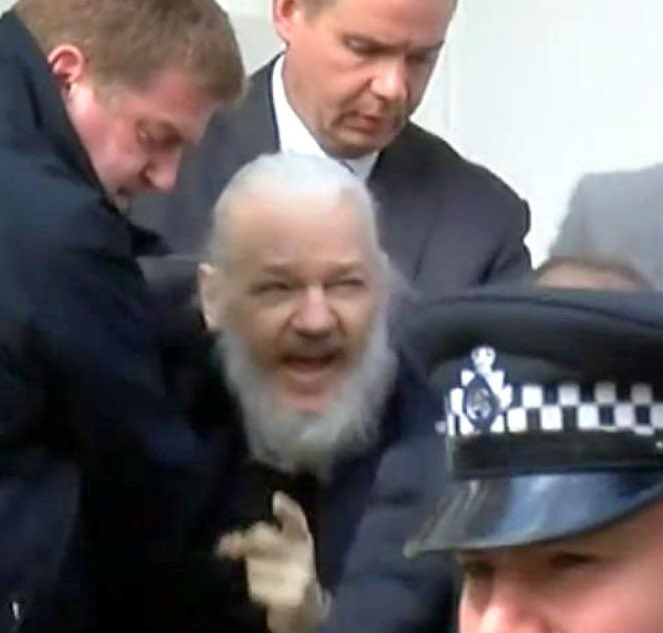 Assange being grabbed and arrested from  the Ecuadorian Embassy by London police