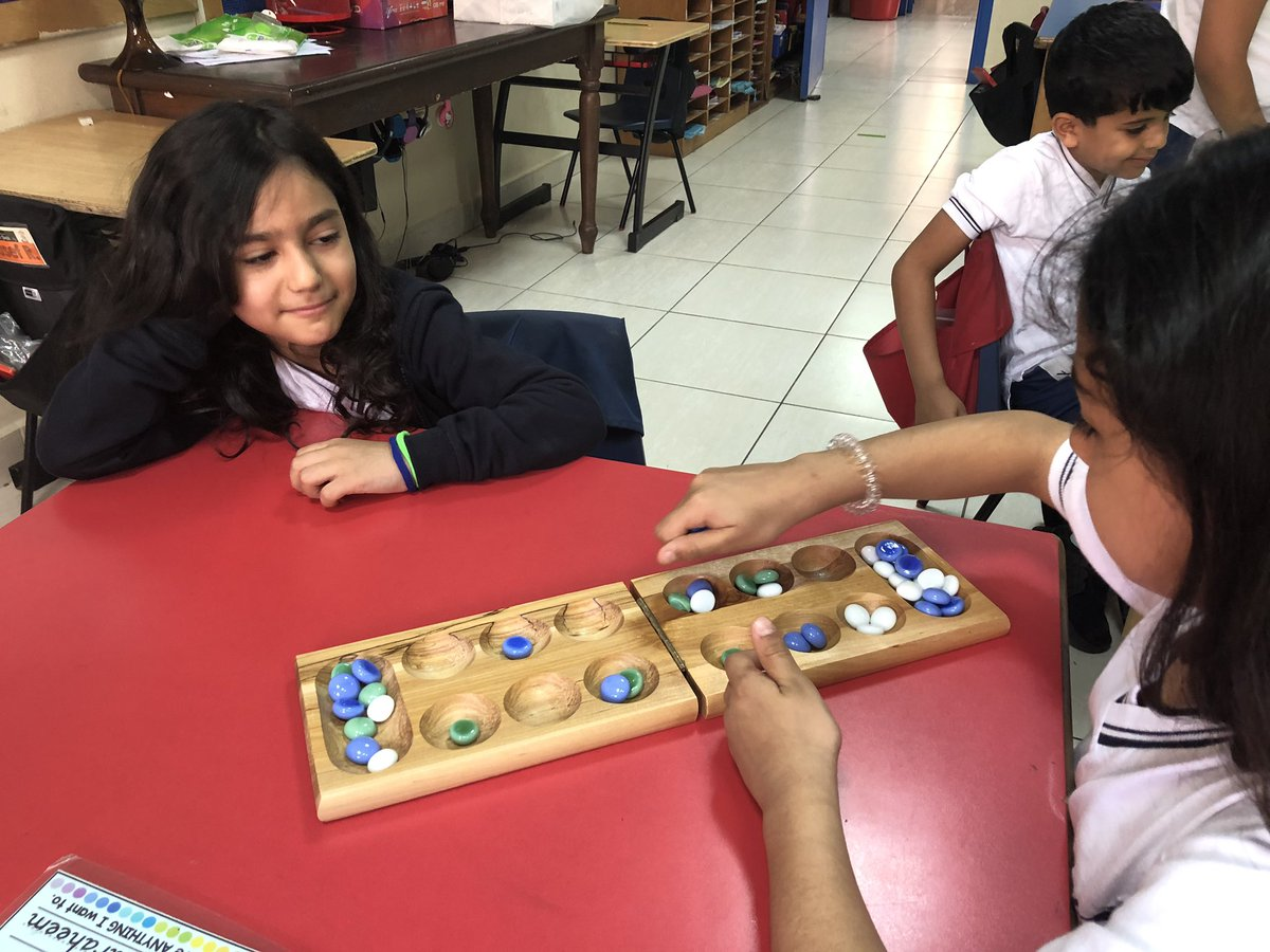 #Playing games in Ms. Cassie's class during Desert day @AISQ8official . Kids had a great time, and I learned how to play #Mancala! #alwayslearning #disguisedmathfun #grade1 #
