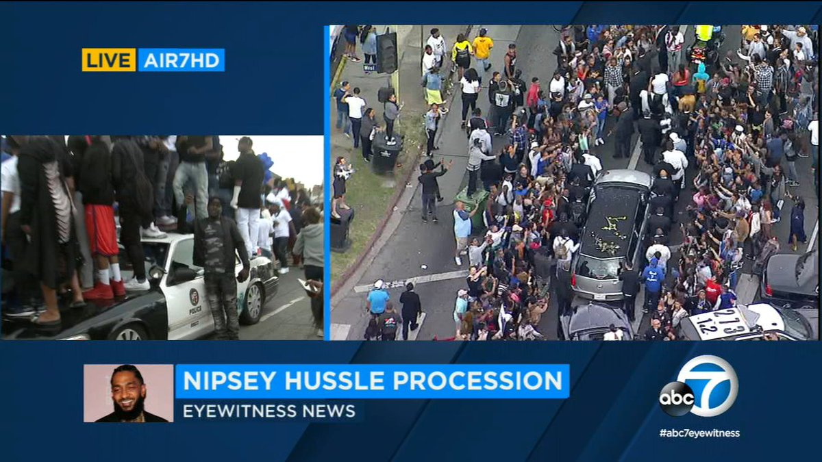 """Crowds peaceful at #NipseyHussle procession, but many are standing on police cars to watch; one LAPD cruiser tagged with """"Nips in Paradise"""" https://abc7.la/2VHylWg"""