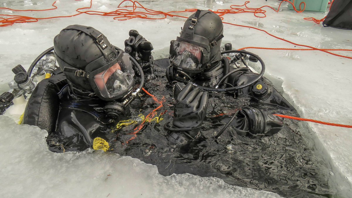 Preparing to descend under the ice. #icediving