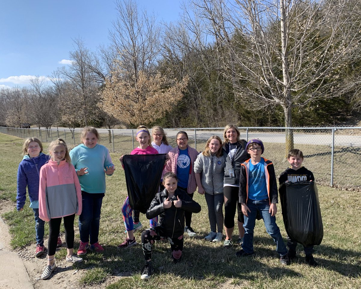 Student Council members doing some spring cleaning outside #lctitanhill with Ms. Kudrin!