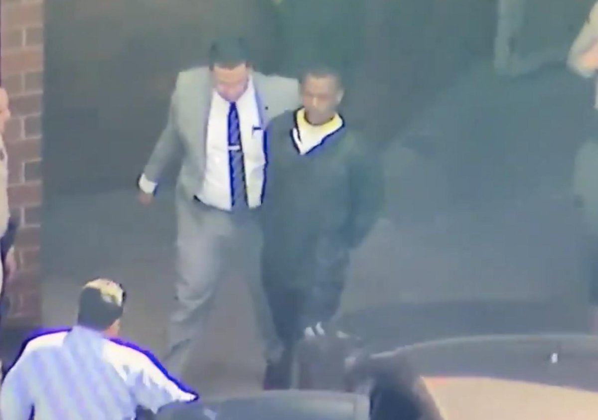 Eric Holder, Nipsey Hussle's killer, being escorted by LAPD.