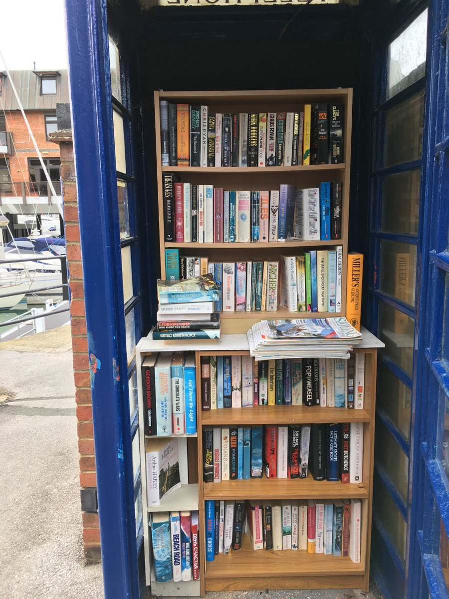 A telephone box library - what a great idea. People leave books for others to take home and read. #Library #Books #TelephoneBoxes