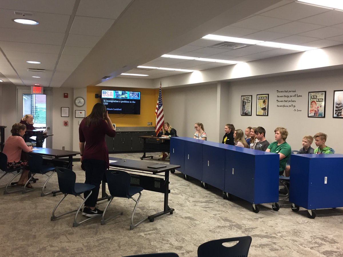 Court is in session at CMS today!  Mrs Hetheringtons ELA classes have been researching debate topics.  A live court in the LMC is their final step in this objective. @CMSCardinals @ClintonMoCards