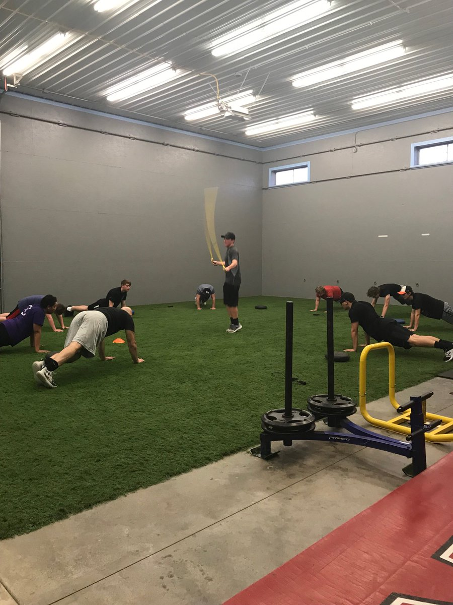 Team planks while guy in hot seat jumps rope. Getting better everyday.