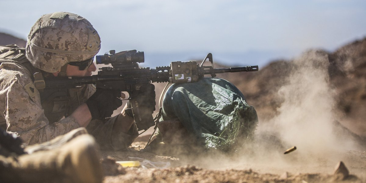 Kickin' Up Dust  Cpl. Ethan T. Lopez, a team leader with 5th Platoon, Charlie Company, Fleet Anti-Terrorism Security Team, Central Command, fires an M4 service rifle during a live-fire range at Camp Titin, Jordan.