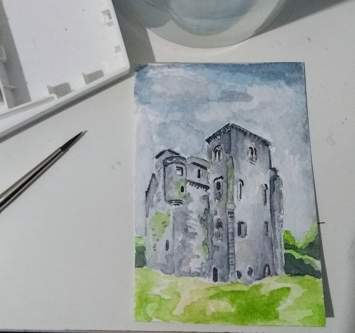 I did another tiny painting, this time of a castle!
