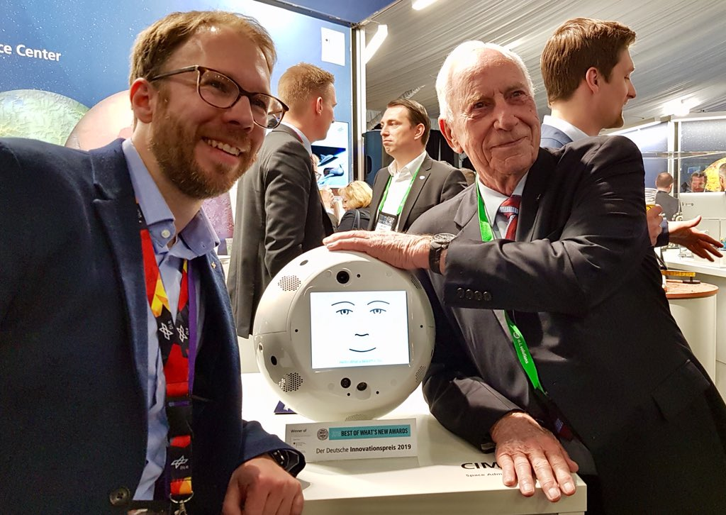 Astronaut 👨🚀 meets Astronaut 🤖: #Cimon with Al Worden, Apollo 15 pilot of the command module at #SpaceSymposisum.  Such an honor for our astronaut assistant 🙏. Left: Christian Karasch, Cimon Programme Manager from our customer @DLR_de.