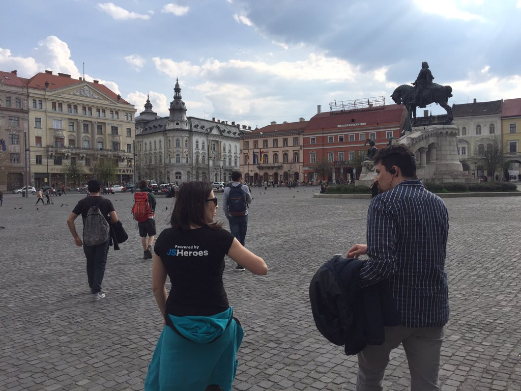 Tour group walking through a city square in Cluj-Napoca on a sunny day