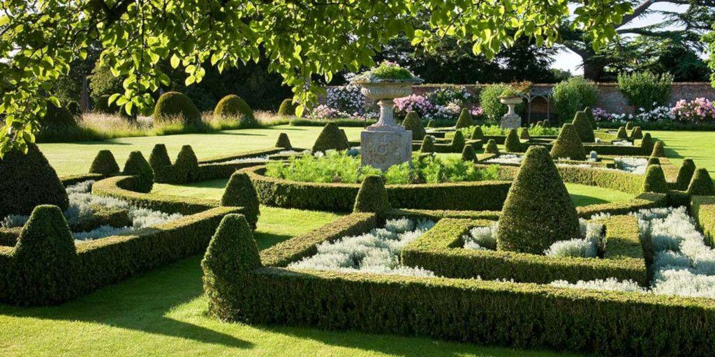 Sculptured gardens at Helmingham Hall Gardens