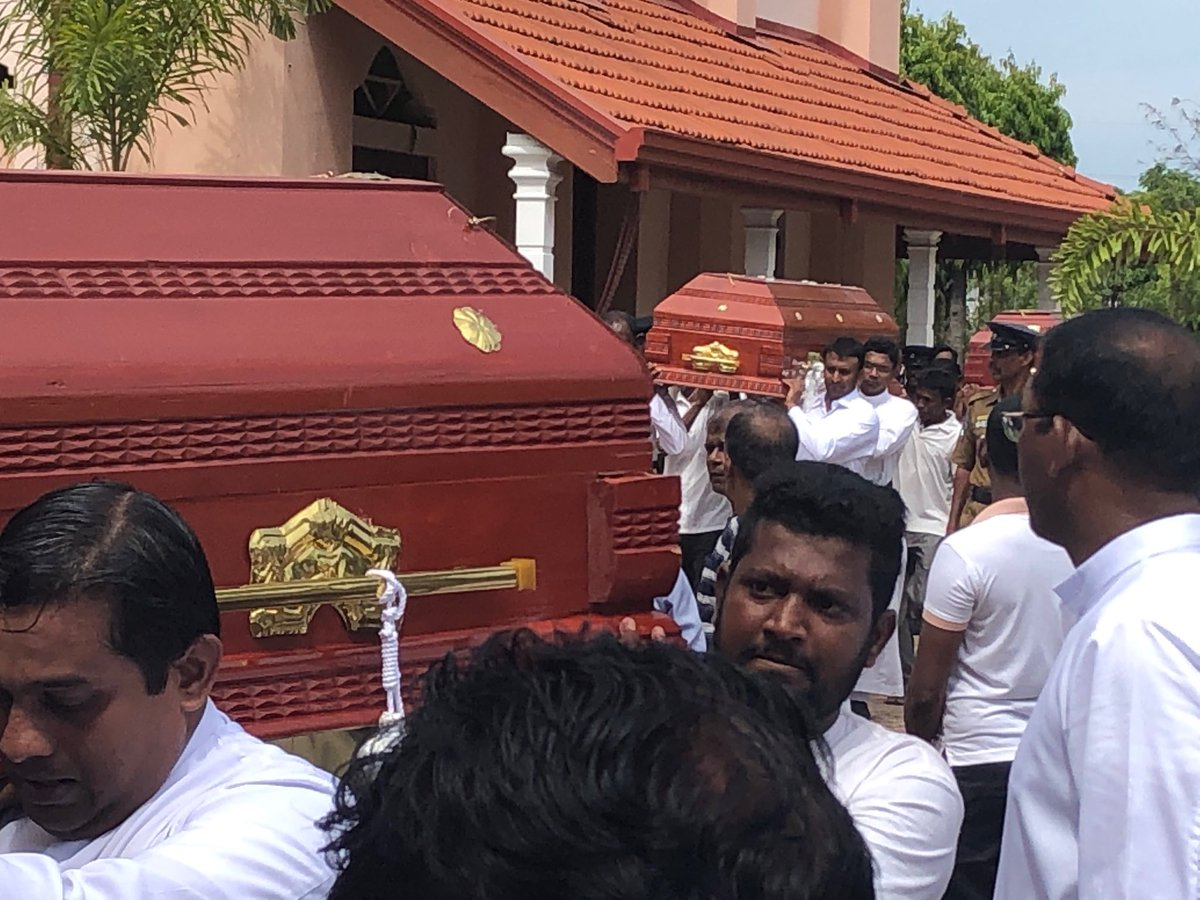Bodies are being carried over by relative to offer final rights at the Katuwapitiya church. Hundreds gathered to honor #EasterSundayAttacksLK victims<br>http://pic.twitter.com/zrKGtrIxBb