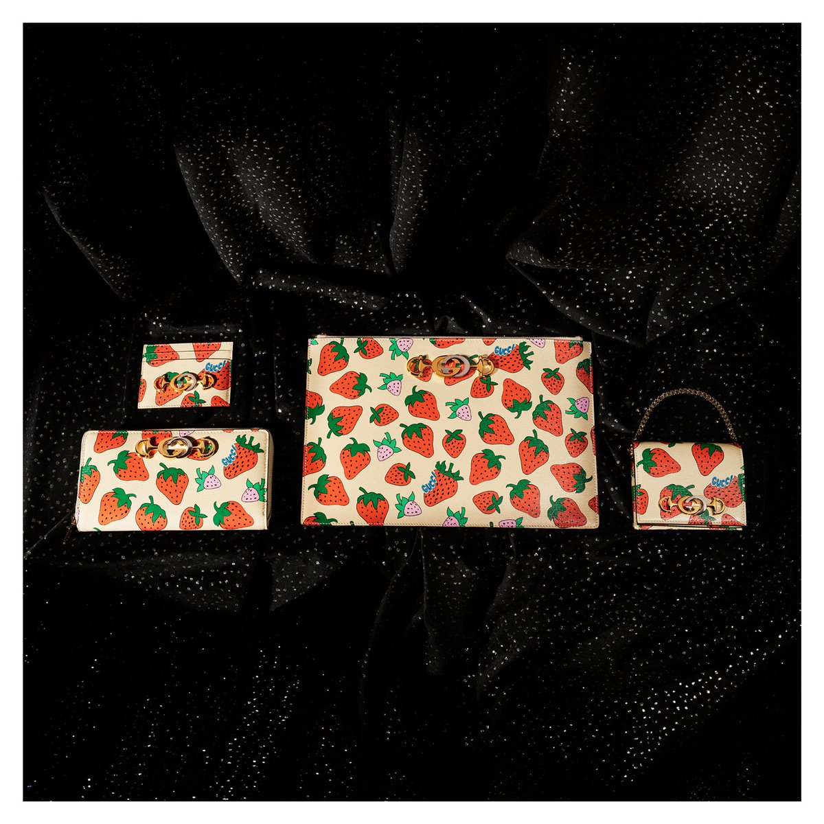 1765ab516 printed onto a leather base a strawberry pattern embellishes diverse  designs of the new accessories designed