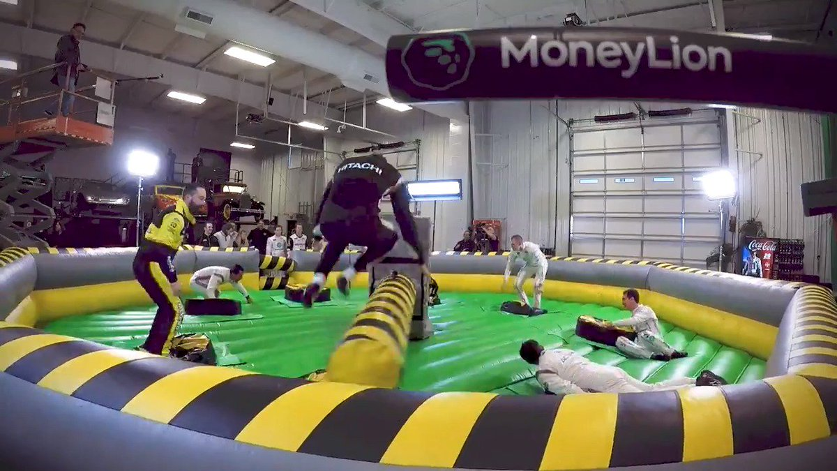 14 race car drivers + an inflatable sweeper arm? What could go wrong? 😂  Check out the newest #PenskeGames presented by @MoneyLion! 🦁