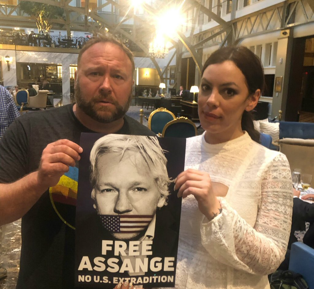 We are at Trump Hotel with #FreeAssange posters