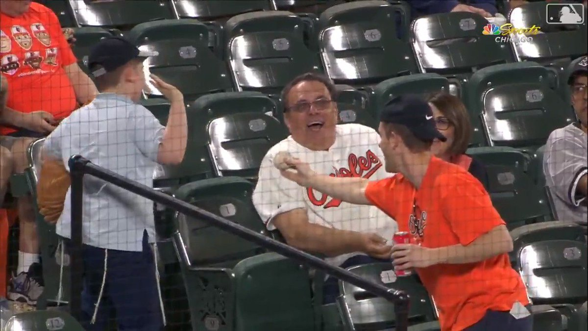 You have to respect the pettiness of this fan refusing to accept a souvenir from his rival