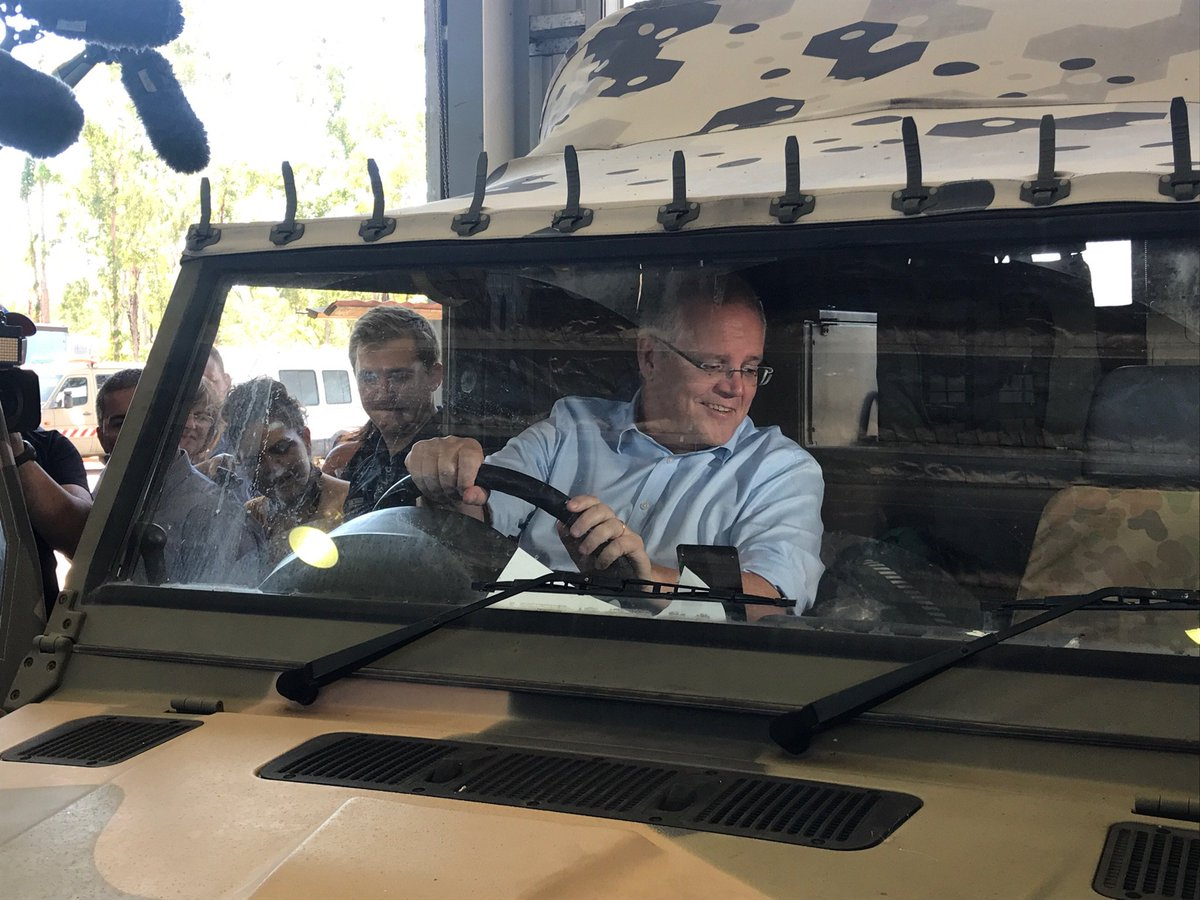It's a big truck. @ScottMorrisonMP gets behind the wheel in Darwin #ausvotes19 <br>http://pic.twitter.com/SaJAd8RtVq